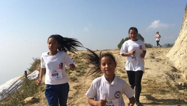 Putting Shoes on Children's Feet: Running with Mira Rai in Sano Dumma